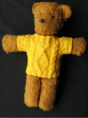 Cable knitting teddy bear jumper example